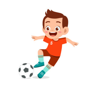 Young boy play soccer as striker