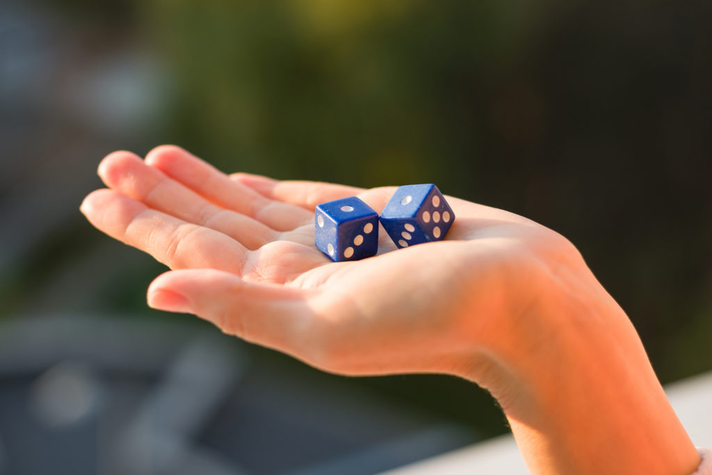 Two dice in hand