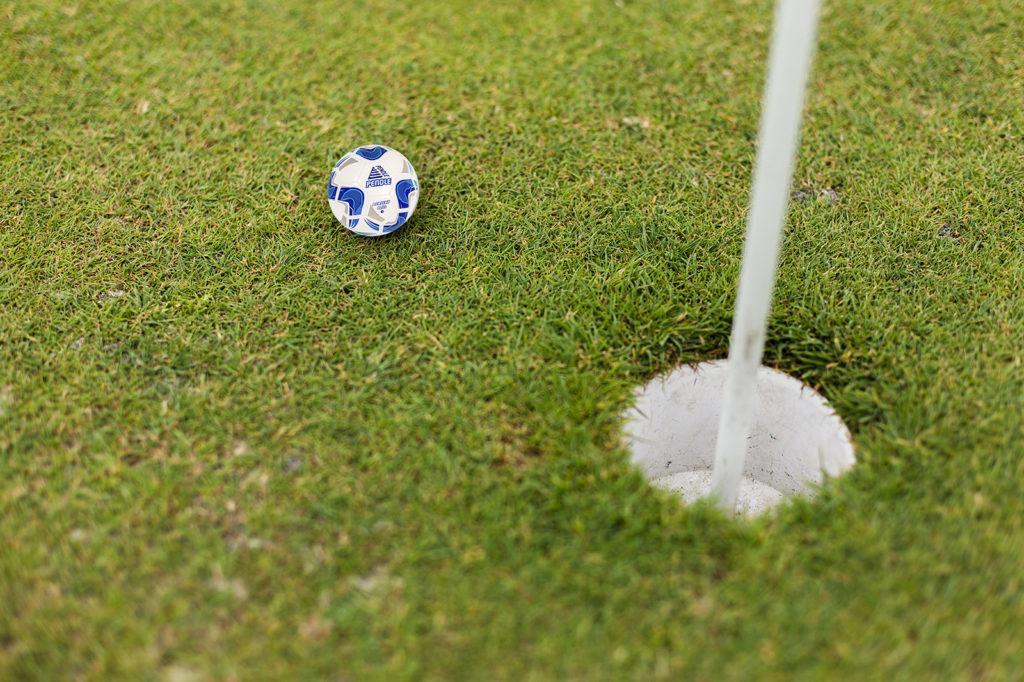 Pendle football near a golf hole