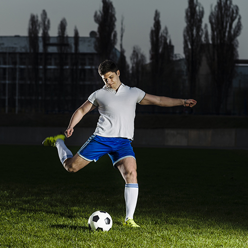 Football player shooting a ball