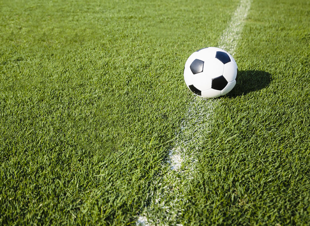 Football on a pitch