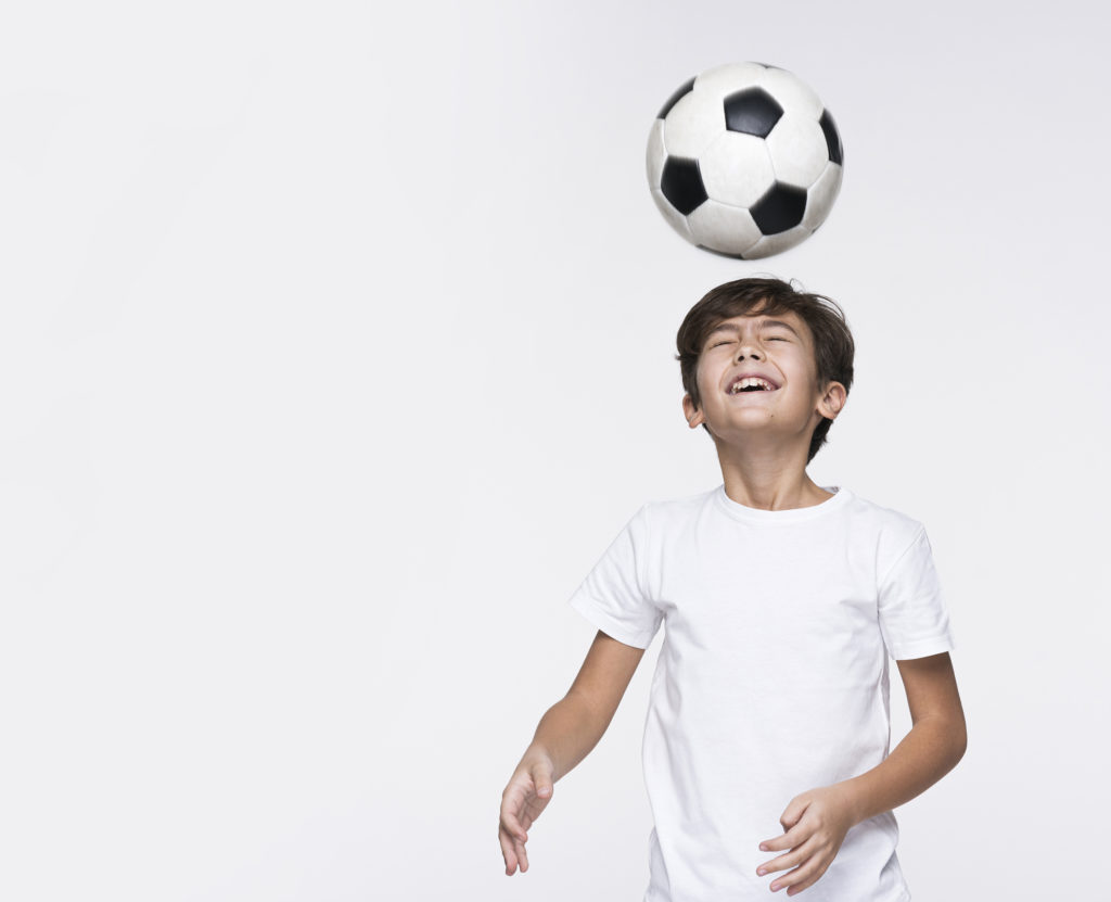 Child heading a football