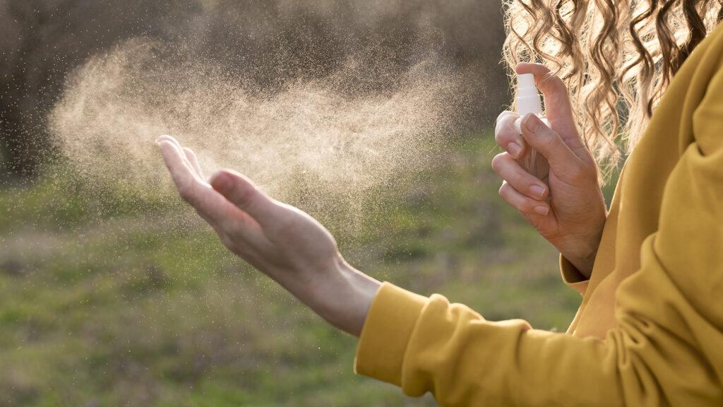 Woman using hand sanitiser