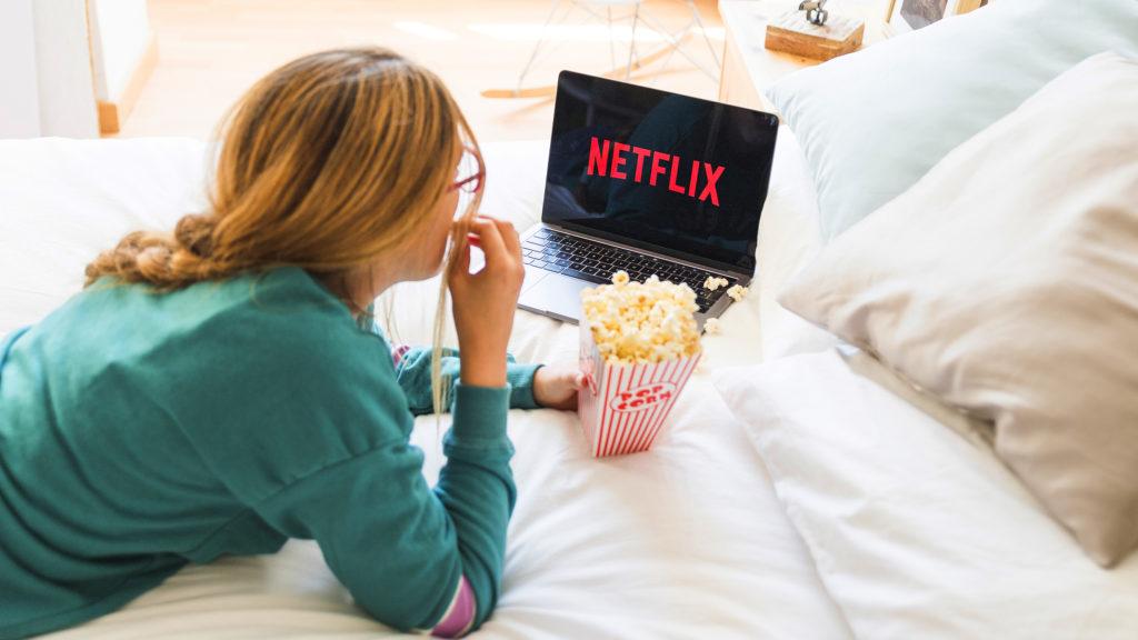 Woman watching Netflix on laptop