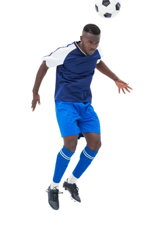 Football player heading a ball