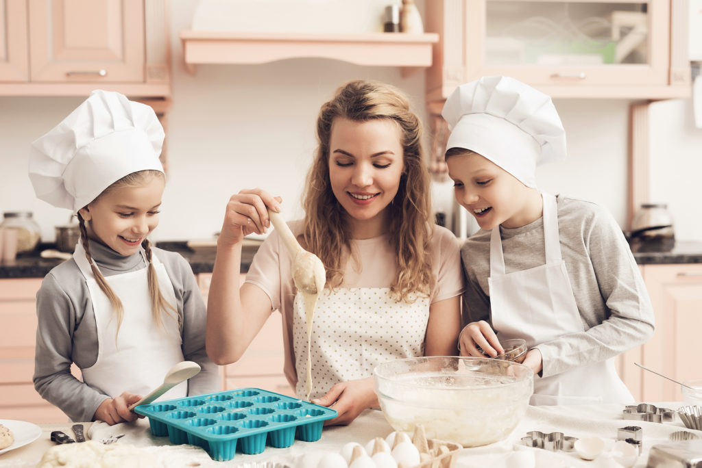 Family baking cupcakes