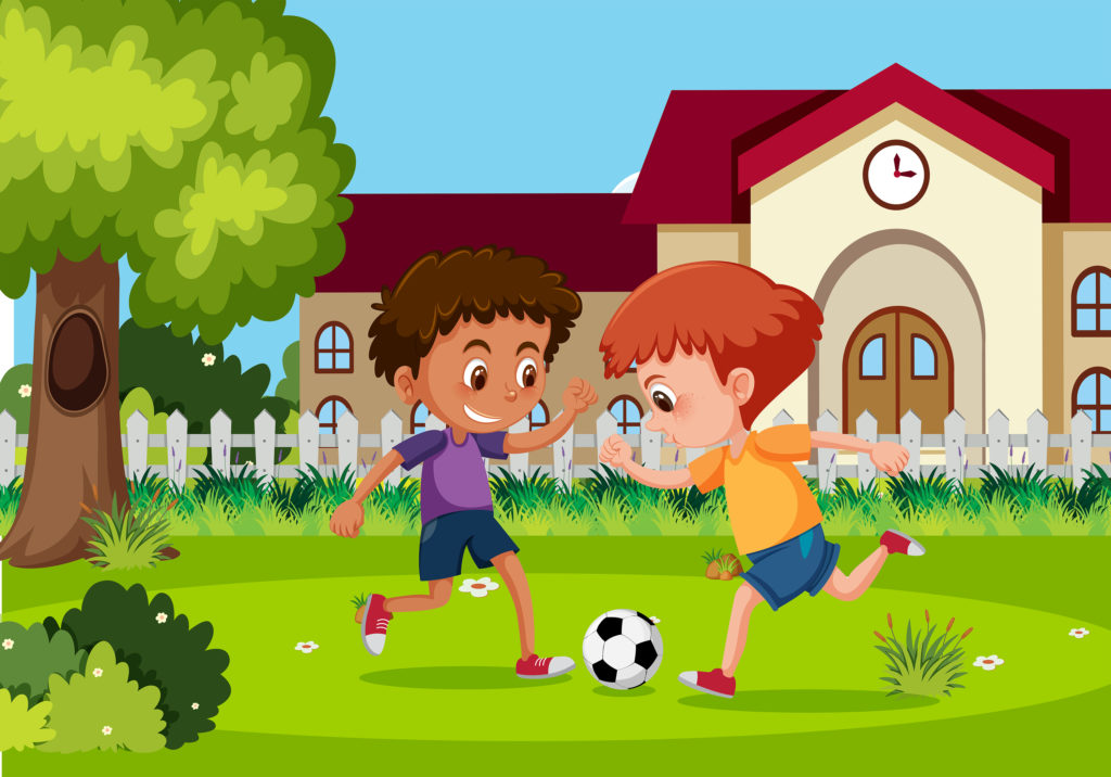 Two boys playing football in the garden