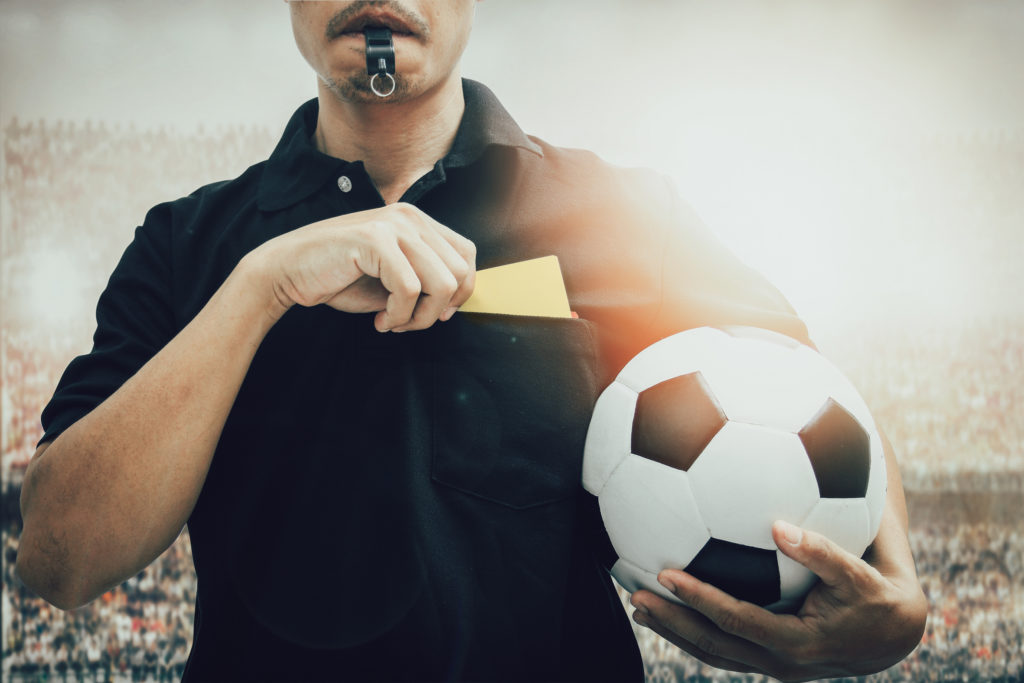 Football referee getting yellow card
