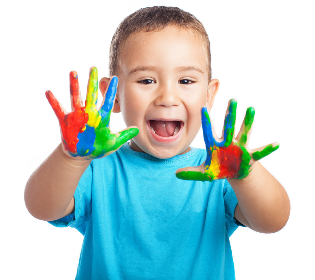 Young boy with paint on his hands
