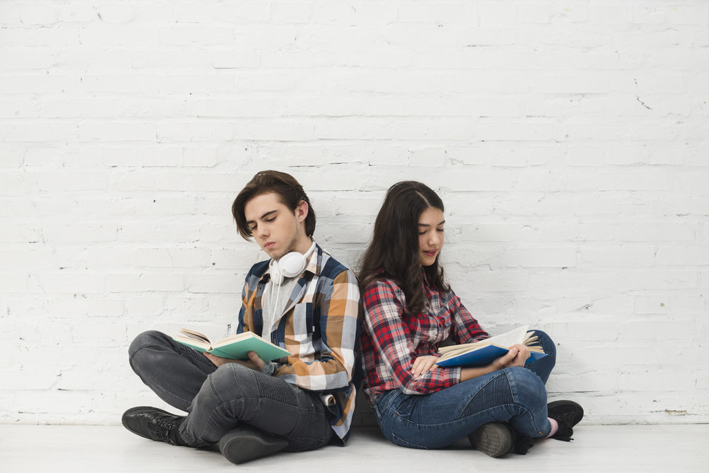 Two teens reading