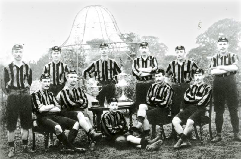 The Wolverhampton Wanderers team that won the FA Cup. The team poses with the trophy