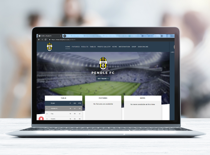 Football club website displaying on a laptop